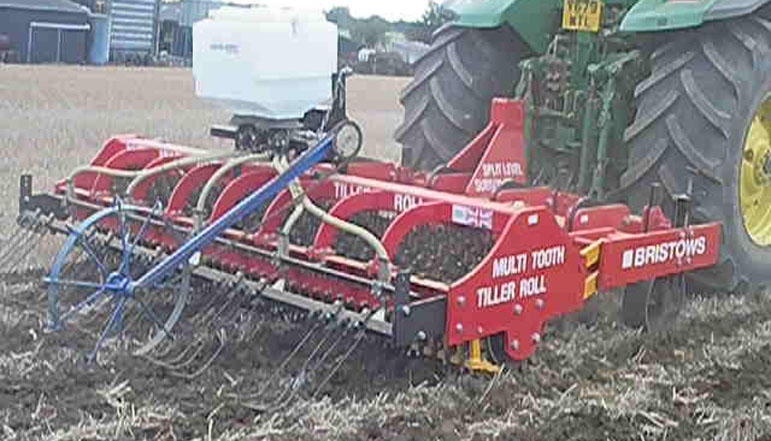 Dean wesley compares his subsoiler with DD rings to the Bristow's tiller roll
